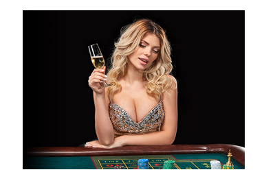 An attractive blond woman at the roulette table.  Drinking champagne.