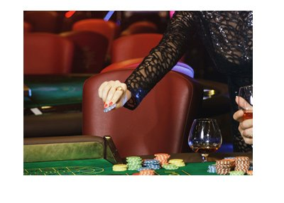 Young couple is having fun at the casino roulette table.  When is a good time to tip the dealer?