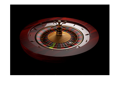 Fancy roulette table made out of wood.  The background is black. Game payouts.
