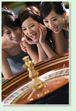 oriental girls playing roulette in a real casino