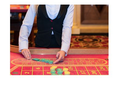 Live female dealer shown in front of a red roulette table.