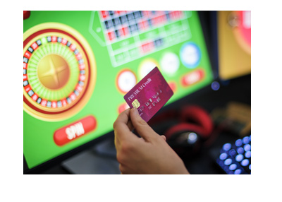 The credit card is pulled before commencing a game of online roulette.  Are online casinos safe?
