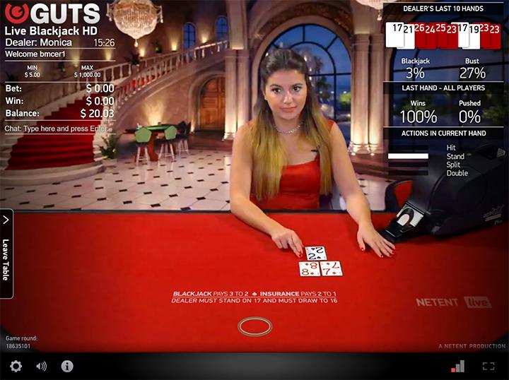 The blacjack live dealer Monica at Guts.com online casino.