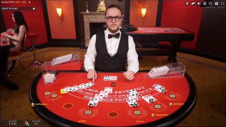 Blackjack live dealer at Guts.com.  Red felt table. - Year is 2017.