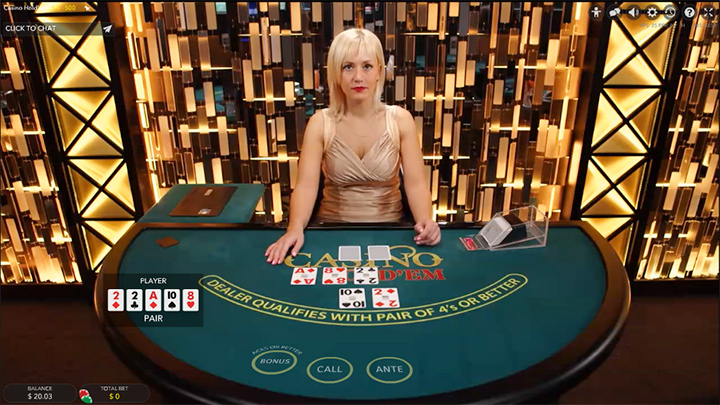 Live casino dealer at Guts.com.  Attractive blond woman in a gold coloured outfit.